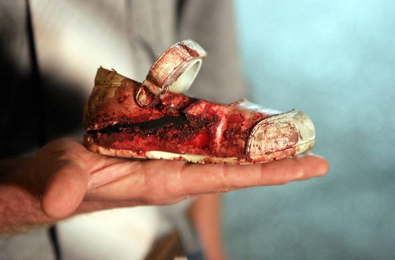 Bloody_child's_shoe_after_rocket_fired_from_Gaza_hit_Israel
