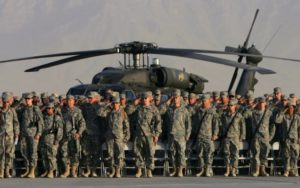 U.S. troops salute during a military ceremony at the Bagram airbase, north of Kabul, September 11, 2006 to commemorate the fifth anniversary of the September 11, 2001 attacks. REUTERS/Ahmad Masood (AFGHANISTAN)